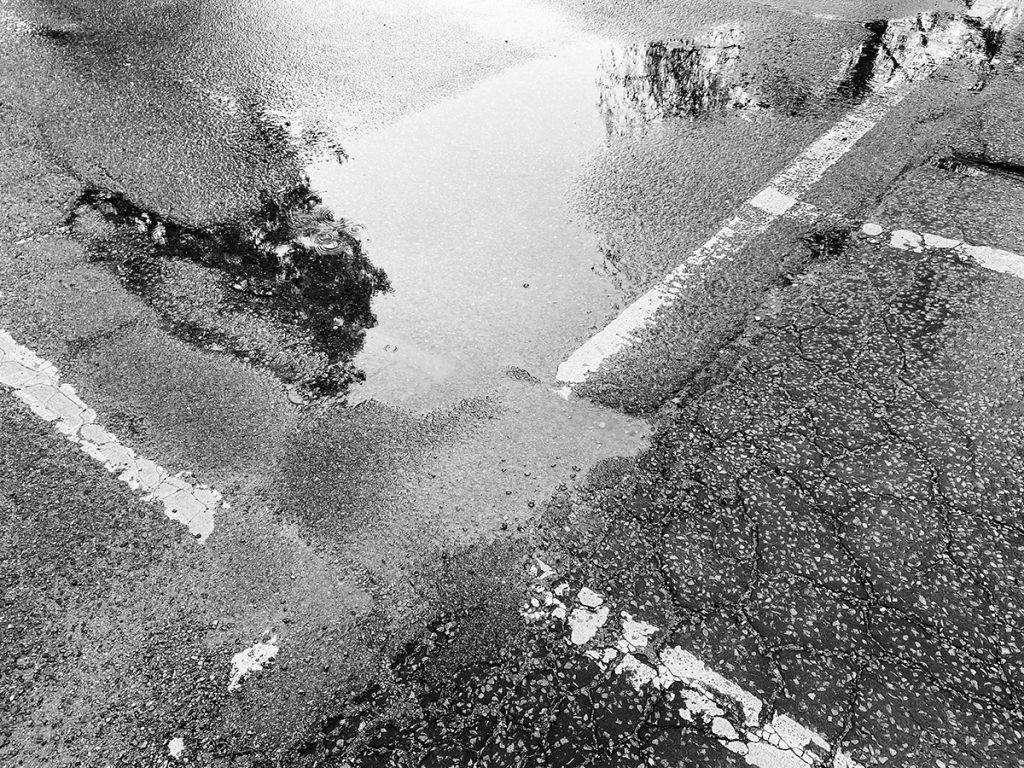 murpworks - murpworkschrome - One last 11 Shot - Street Lines in the Wet black and white image
